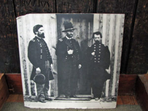 Grant, in the middle, at the door